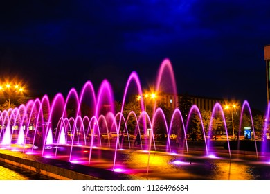 Beautiful picturesque  multi colored fountain at night in Dnipro city, Ukraine.  (Dnipropetrovsk, Dnepr, Dnepropetrovsk)