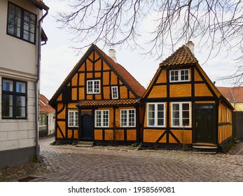 Beautiful picturesque small street street with old houses in tourist attraction port city of Faaborg Funnen Denmark