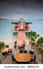 A beautiful pier going into silky and smooth tropical waters