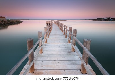 Beautiful pier sunset in Moinho de Mare in Setubal, Portugal