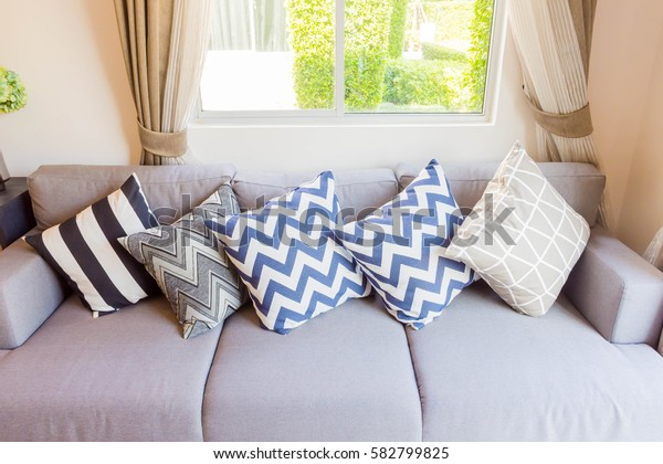 Beautiful pillow on sofa decoration in living room interior