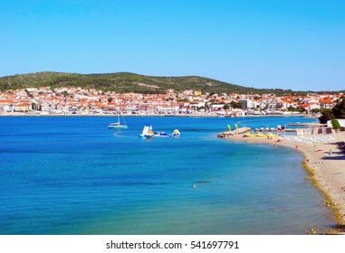 Beautiful pine beach on the background of the cityscape of Vodice in Croatia.