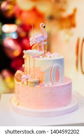 Beautiful pink 10th birthday cake with flamingo