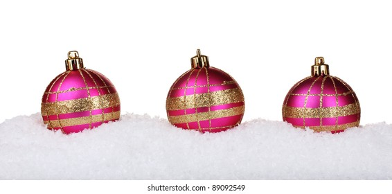 beautiful pink Christmas balls in snow isolated on white