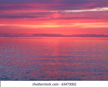 Beautiful pink colors reflect off Lake Superior in northern Michigan