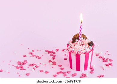 Beautiful pink cupcake with birthday candle