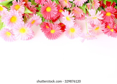Beautiful pink flower border on white background and copy space