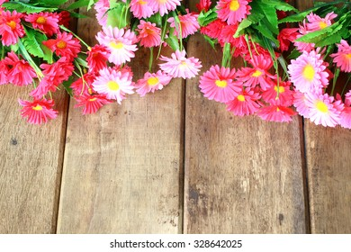 Beautiful pink flower on wooden background and copy space