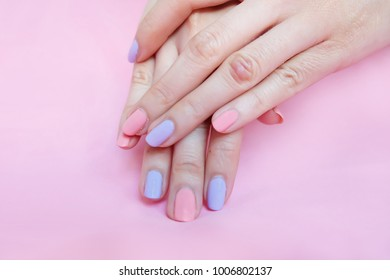 Beautiful Pink Nail Polish. Female Hands with Pink Nails Manicure on Pink Fabric Background Great for Any Use.
