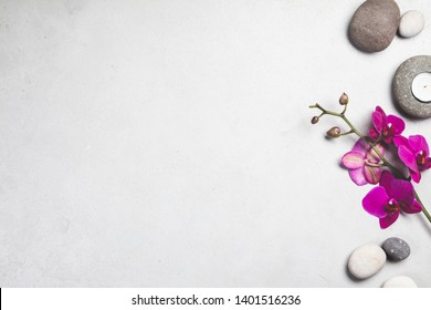 Beautiful pink Orchid Flowers on Spa Stones