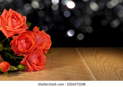 beautiful pink rose that lies on wooden boards