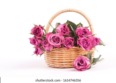 Beautiful pink roses in a wicker basket on a white background. Isolate Concept Valentine's Day, Mother's Day. Holiday gift.