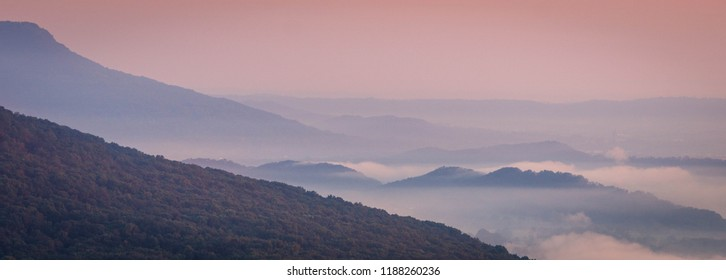 Beautiful pink sunrise over a misty Tennessee Valley from Signal Point. Located on Signal Mountain near Chattanooga, Tennessee.
