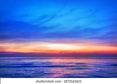 Beautiful pink sunset, blue sky, purple sea background, blurred watercolor sunrise, quiet ocean beach landscape, peaceful morning seascape, idyllic dawn nature, calm soft dusk, gentle sun light glow