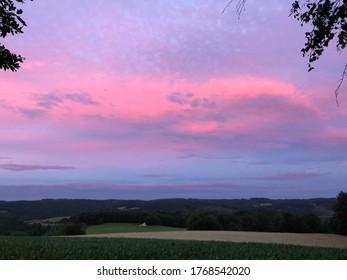 beautiful pink sunset over fields