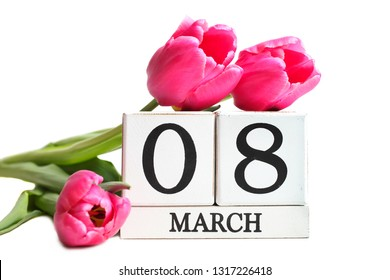 Beautiful pink tulips and calendar isolated on white. Concept International Women's Day, March 8.