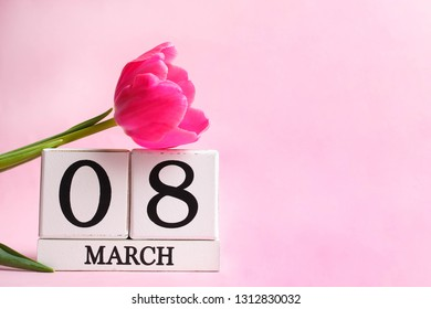 Beautiful pink tulips and calendar on pink background. Concept International Women's Day, March 8. Copy space.