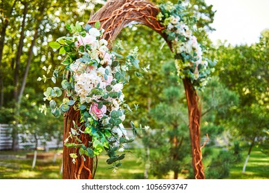 Beautiful pink and white flowers and greenery on wedding arch prepared for wedding ceremony outroods, copy space. Wedding ceremony decorations, free space
