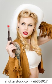 Beautiful pinup model dressed as Cowgirl