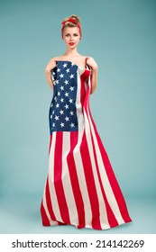 Beautiful pin-up style fashion model in dress made from american flag