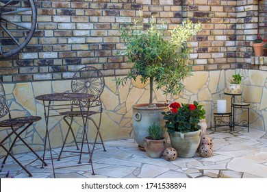 beautiful place in the garden in the mediterranean style, brick wall with grill and pots with flowers