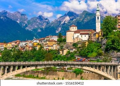 Beautiful places of northen Italy - picturesque Belluno town surrounded by Dolomites mountains