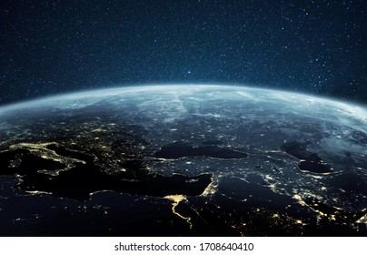 Beautiful planet earth with night city lights. Europe and Africa at night viewed from space with city lights showing human activity in Germany, Poland, Italy, Egypt, Greece and other countries.