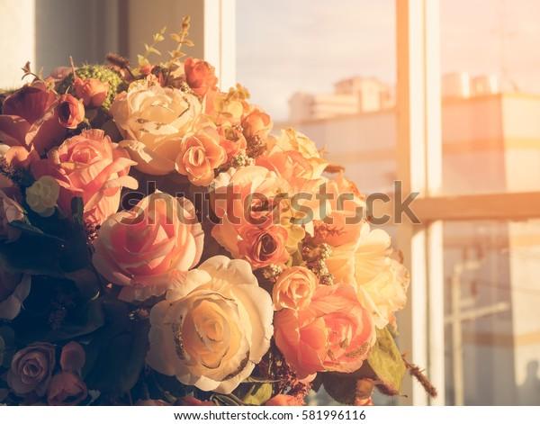 Beautiful plastic flowers vintage tone style for postcard.