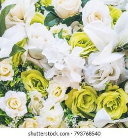 Beautiful plastic rose flowers background.