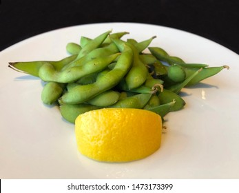 A beautiful plate of edamame served with lemon