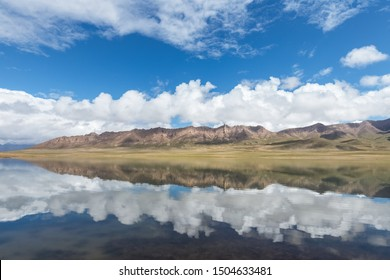 beautiful plateau lake and blue sky reflection , natural landscape on qinghai-tibet plateau , golmud kunlun mountain hinterland, China