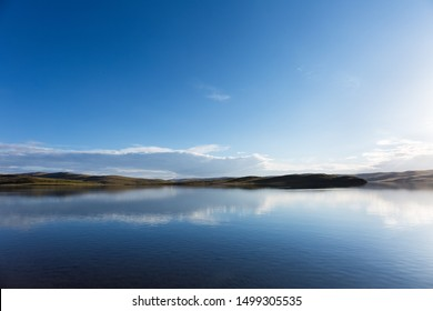 beautiful plateau lake and reflection with blue sky, madoi county, qinghai province, China