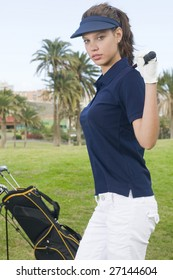 beautiful player golf with her club and bag