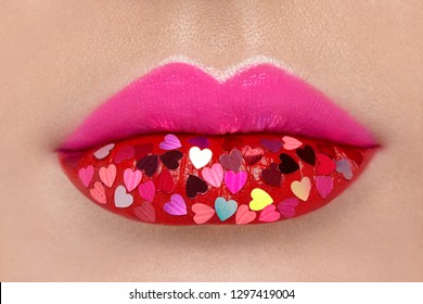 Beautiful Plump Pink Lips with pasted Hearts. Beauty Sexy Lips with Red Lipstick. Valentine's Day. Beautiful Love Make-up