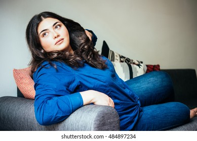 Beautiful plus size girl lying on the sofa