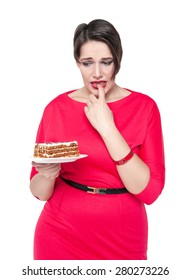 Beautiful plus size woman temptating with cake isolated