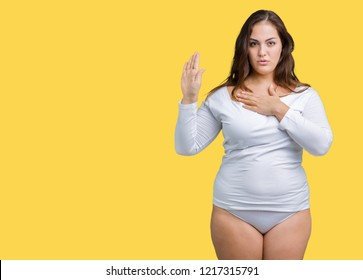 Beautiful plus size young overwight woman wearing white underwear over isolated background Swearing with hand on chest and open palm, making a loyalty promise oath