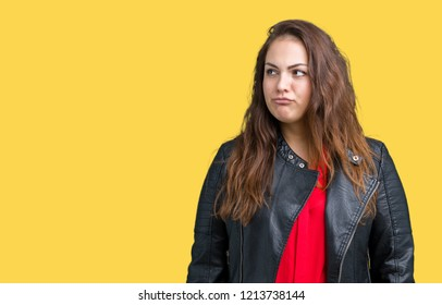 Beautiful plus size young woman wearing a fashion leather jacket over isolated background smiling looking side and staring away thinking.