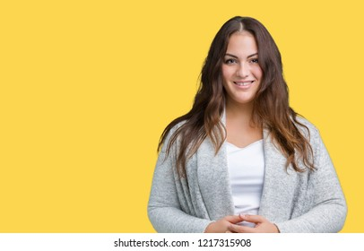 Beautiful plus size young woman wearing winter jacket over isolated background Hands together and fingers crossed smiling relaxed and cheerful. Success and optimistic