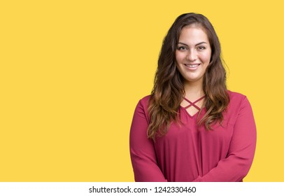Beautiful plus size young woman over isolated background happy face smiling with crossed arms looking at the camera. Positive person.