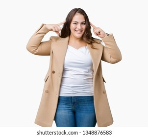Beautiful plus size young woman wearing winter coat over isolated background Smiling pointing to head with both hands finger, great idea or thought, good memory