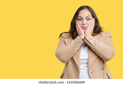 Beautiful plus size young woman wearing winter coat over isolated background Tired hands covering face, depression and sadness, upset and irritated for problem