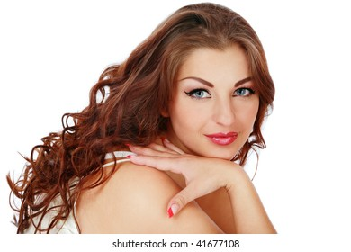 Beautiful plus-size woman with brown curly hair, over white background