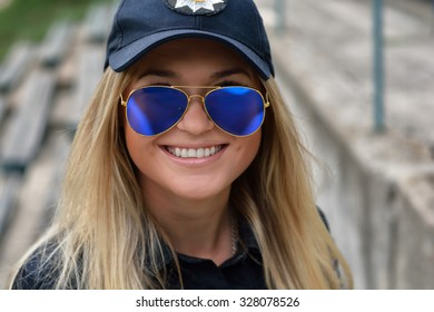 Beautiful Police Girl posing in park and at the police station