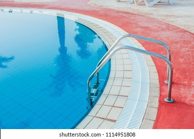 beautiful pool with steps near the sea on nature background