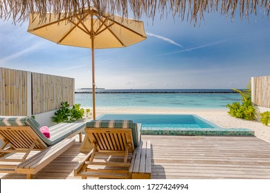 Beautiful poolside and blue sky beach. Luxurious tropical beach landscape from private villa with deck chairs loungers and sea water. Summer travel vacation landscape. Exotic tourism landscape view
