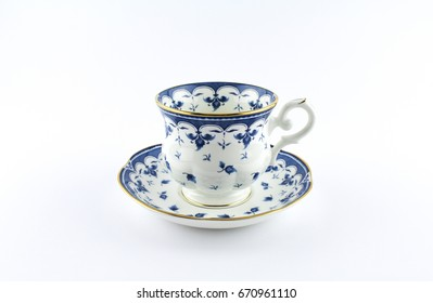 Beautiful porcelain cup with blue and gold design