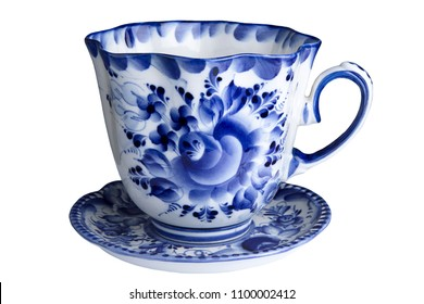Beautiful porcelain Cup on a saucer, painted in the style of Gzhel. Close up. Isolated on white.