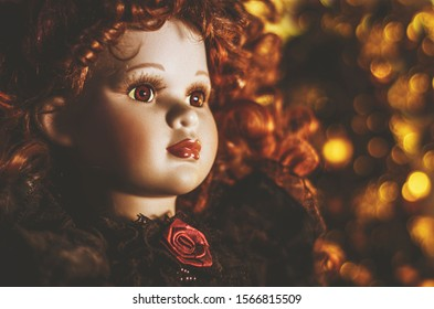 Beautiful porcelain doll with red curly hair.