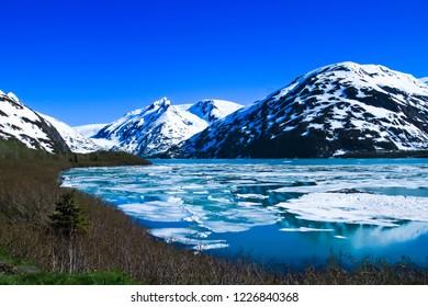 Beautiful portage lake near Whittier tunnel in early summer Whittier Alaska usa